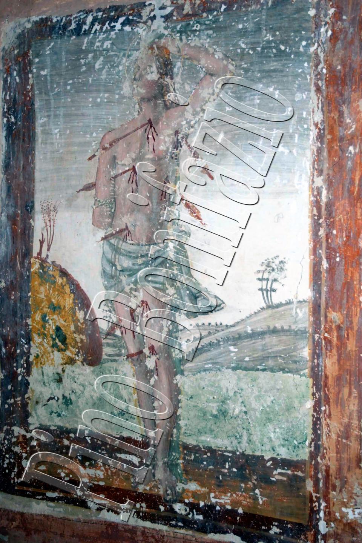 Chiesa di S. Lucia nel borgo  S. Lucia di Isola del Gran Sasso (TE) . San Sebastiano, affresco fine  '400