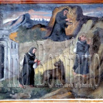 Assergi (AQ), chiesa di S. M. Assunta- Dopo due anni sceglie la vita eremitica e un orso lo guida nella  sua prima grotta.