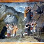 Assergi (AQ), chiesa di S: M. Assunta. San Franco salva cinque uomini da una frana e in ginocchio lo ringraziano
