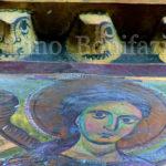 Subiaco - Sacro Speco, volti apotropaici al di sopra del roseto